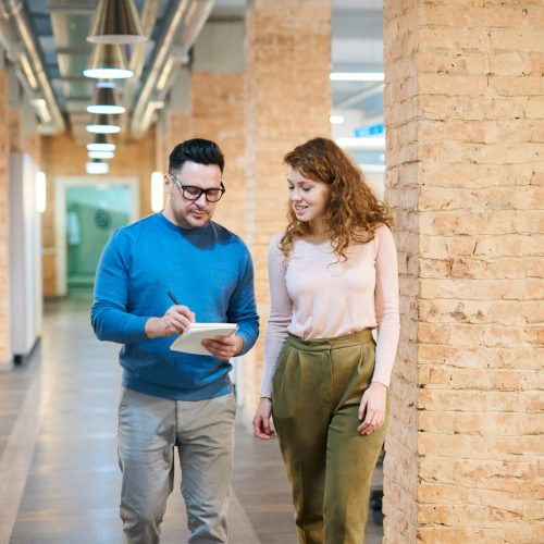 photo-of-people-walking-on-hallway-3182811